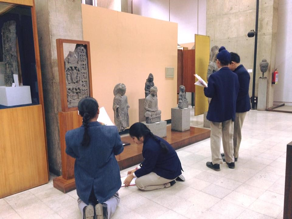 Students explore Gandhara collection to understand Kushan Empire art and promotion of Buddhism